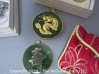 Jewelry lot 219: oriental gold tone calligraphy pendents (jade and tigereye)and silver heart bookmark from MetMOA