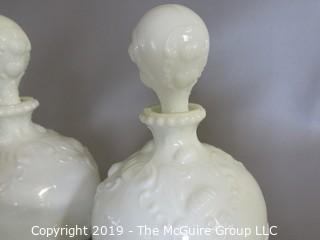 Milk-glass: Three embossed decanters, two with stoppers