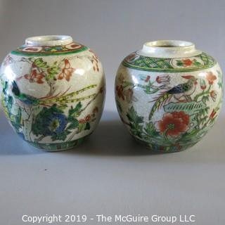 Two Oriental Ginger Jars w/ wood lids and wood bases (one damaged)