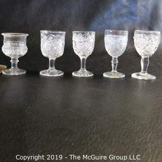 Assortment of Five Stemmed EAPG Glasses