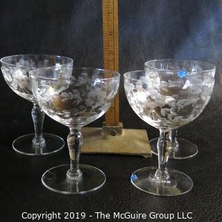 Five etched stemmed glasses