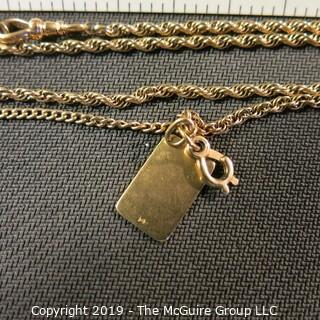 "Jewelry:  Double rope 14K chain, 24"", with bezel clasp with 3/4/ x1/2"" in flat, charm. 16 grams (TMG 738)"