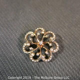 Jewelry:  Vintage floral motif, 14K. Seed pearl,  3 point center diamond brooch, 24 mm diameter; 2.9 grams (TMG 777)