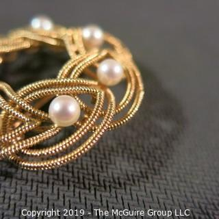 Jewelry: Double woven strands, 14K circle brooch (1.5 in.) with 8 pinkish white pearls at 4.5mm, 10.8 grams total weight (TMG 731)