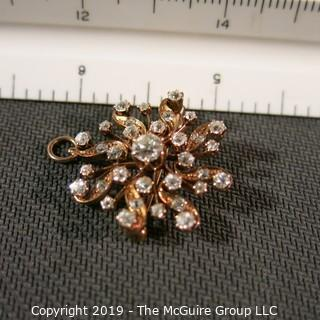 Jewelry: Rose gold (14K) Diamond Brooch with fold down locket bail, Floral motif, center diamond .50 ct and 1.45 ctw.  Diamonds are eye-clean, bright white (G color); 6.5 grams total weight (TMG 778)