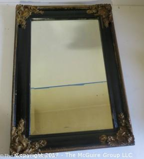 Wall mirror with beveled glass in antique frame; 13 3/4 x 19 1/4