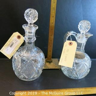 Two (2) EAPG Decanters w/ stoppers 1 w/ handle