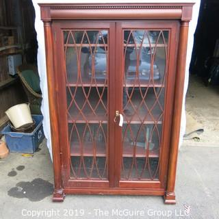 "Furniture: Antique: Bookcase circa 1900; lattice over glass front; sold by Frederick Loeser and Co., Brooklyn, NY; 41W x 15D x 64""T"