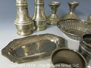 Collectible: Silver: Collection of Sterling including napkin rings, salt and pepper shakers and weighted candlesticks; 650g total weight