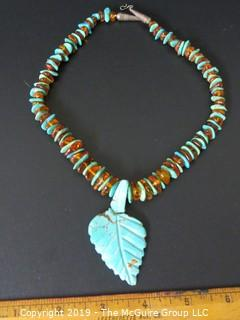 "Jewelry: Necklace: silver: 18"" turquoise and amber necklace; likely coin silver; carved leaf is broken from strand"