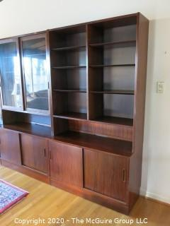 """Danish Mid Century Modern (M-C-M) Bookcase with Lower Cabinet Featuring Sliding Doors.  NOTE: THE PHOTO SHOWS THREE (3) SECTIONS SIDE BY SIDE. THIS LOT CONSISTS OF THE MIDDLE, GLASS FRONT SECTION ONLY.   THE LEFT AND RIGHT SECTIONS ARE BEING SOLD AS LOTS 0001A AND 0001B {Each section is 43"""" wide x 77""""tall; lower cabinet is 17"""" deep, bookcase is 12"""" deep}"""
