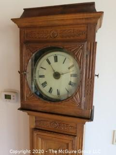 "Carved European Oak Grandfather Clock in Case; hand-painted face and handmade movement; 84"" tall and 22"" wide; untested"