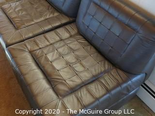 """Leather Sectional Seating - NOTE: THIS LOT IS COMPRISED OF (2) LEATHER SECTIONALS AND (2) GLASS-TOP DISPLAY BOXES; LOT 0035B IS COMPRISED OF (2) LEATHER SECTIONALS} each chair sectional is 27"""" x 30"""" x 14"""" tall; shadow boxes are 27 x 27 x 14"""" tall; ottoman is 27 x 27 x 14"""" tall"""