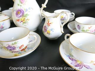 Set of Hand Painted Floral Dresden Porcelain Coffee Service including cups & saucers, demitasse cups & saucers, plates, Coffee Pot, Creamer and Sugar.  Made in Germany
