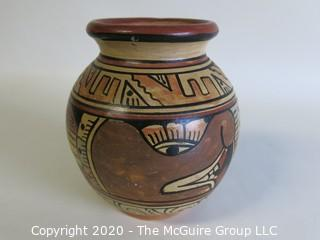 "Hand Thrown and Painted Red Clay Pottery Vase, Made in Peru. Measures approximately 5"" x 4"""