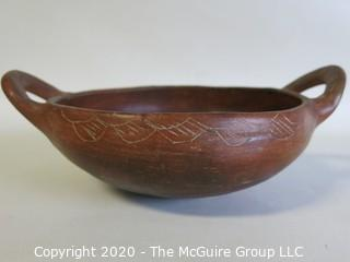 "Hand Thrown and Painted Red Clay Double Handle Bowl. Made in Peru. Measures approximately 7 1/2"" X 3"""