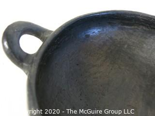 """Hand Made Black Clay Pottery Double Handle Bowl with Edge Decoration. In the style of Barro Negro Pottery of Oaxaca, Mexico. Measures approximately 7"""" in diameter"""