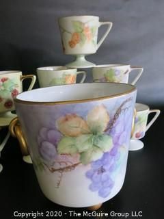 Set of 8 Floral Patterned Porcelain Footed Cups and Urn.  Hand Painted and signed by Artist.