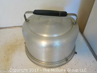 Collection of kitchenware including covered baking pots, and an aluminum pie/cake carrier
