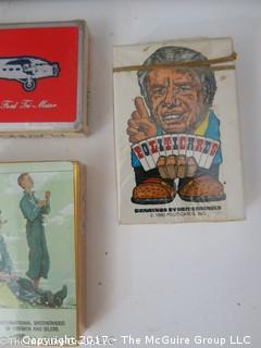 """Collection including """"The Last Whole Earth Catalog; NIB Zippo lighter; Tiffany bag; and several unopened packs of playing cards"""