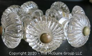 Set of 7 Antique Glass Door Knobs in Scallop Design with Brass Fittings.