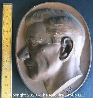 """Large Plaque Made of Plaster with Copper Color Paint of Man in Profile.  Signed RAS 1933 with Wall Hanger.  Measures Approximately 12"""" Long."""