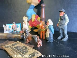 Group of Miscellaneous Items.  Includes Wood Juggling Pins, Carved Figures, Porcelain Figures, Faux Money and Large Duck Toy Made by Remple of Akron OH.