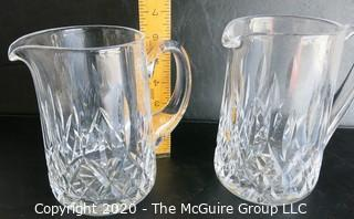 """Set of Two Crystal Pitchers. Measure approximately 6 1/2"""" tall.  Some damage on one of the handles."""