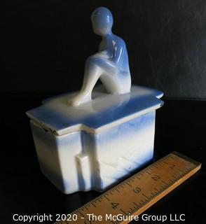 """Blue and White Art Deco Pottery Talcom Powder Box with Figure on Lid.  Some chips on edges. .  Measures approximately 5 1/2"""" x 5""""."""