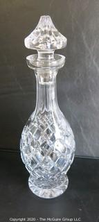 "Cut Crystal Decanter with Stopper. Measures approximately 13"" tall."