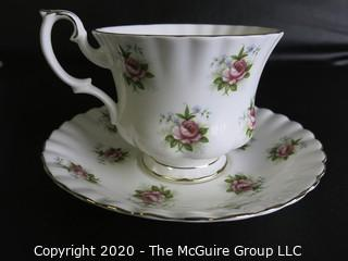 Porcelain Bone China Teacup and Saucer in Forget Me Not pattern made by Royal Albert in England.