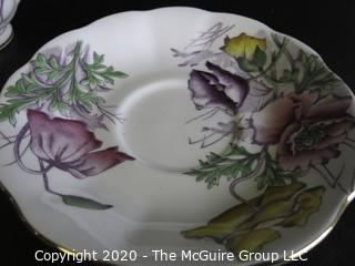 Porcelain Bone China Teacup and Saucer in the Flower of the Month Series, Poppy, made by Royal Albert in England.