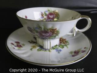 Porcelain Bone China Teacup and Saucer in floral pattern, Unmarked.