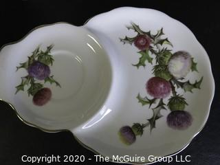 Porcelain Bone China Teacup and Toast Snack Plate in Dundee Thistle pattern made by Queen Anne in England.