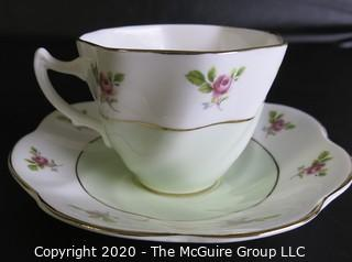 Porcelain Bone China Teacup and Saucer made by Queens in England.