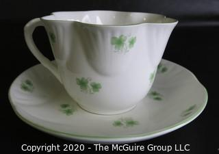 Porcelain Bone China Teacup and Saucer made in Shamrock pattern made by Crown Staffordshire in England.