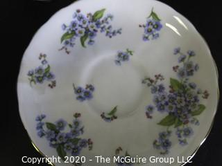 Porcelain Bone China Teacup and Saucer made in Forget Me Not pattern made by Tuscan Fine China in England.