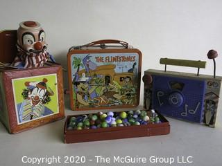 Four Vintage Children's Items.  Includes Box of Marbles, Lunch Box, Jack in the Box and Fisher Price Music Box.