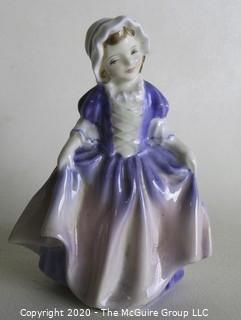 "Vintage Royal Doulton Porcelain Figurine ""Dinky Do"". Measures approximately 5"" tall."
