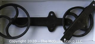 """Two Old R.H. Co. Iron Pulleys.  Measures approximately 17"""" long."""