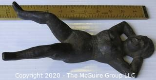 """Vintage Naughty Nellie Cast Iron Boot Jack.  Measures approximately 11"""" long."""