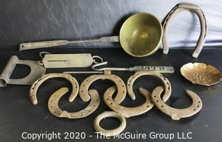 Large Group of Heavy Cast Iron and Brass Tools.  Includes Horseshoes, Hanging Scale with Brass Front, Brass Ladle, Scraper, Mule Shoe, Etc.