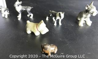 Collection of Dog Figurines of Various Materials and Playing Cards.