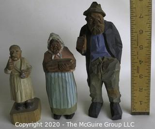 Three Carved Wooden Figurines.