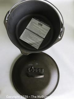 "Lodge Heavy Cast Iron Pot with Lid and Handle.  New with Label inside. Measures approximately 5"" x 11""."