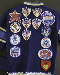Vintage Sweater Covered with United States Figure Skating Association Patches. Size Small. photos are shown of the young skater performing; however, the photos and skates are not part of the grouping).