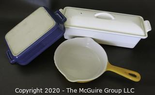 Three Pieces of Cast Iron Enamel Cookware made by Le Creuset  (White Rectangular Casserole & Blue Dish) and Cousances (Yellow Pan).