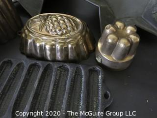Group of Seven Baking Molds and Cast Iron Cooking Pieces.