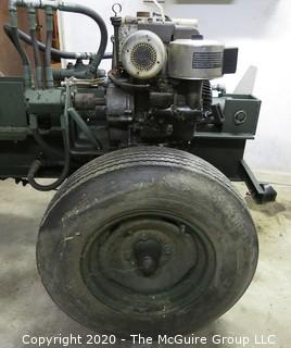 """Working Gas Powered Briggs and Stratton Hydraulic Log Splitter; transportable; 10' long; 31"""" capacity; 8"""" wide I beam; very heavy duty."""
