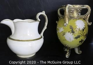 """Large Ceramice Pitcher with Gilt Decoration and Yellow Urn Style Vase with White Floral Decoration.  Measures approximately 14""""."""